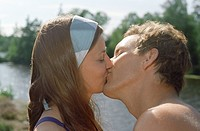 Mid_adult Couple Kissing outdoors side view