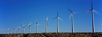 Wind turbines against blue sky (thumbnail)