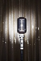 Old fashioned microphone in front of stage curtain (thumbnail)