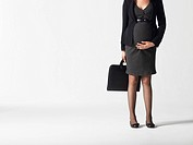 Pregnant businesswoman low section