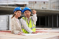 Architect and construction manager having consultation