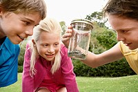 Children Looking at Snake in Jar (thumbnail)