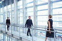 Businesspeople walking in modern building