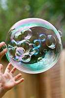 Child catching large bubble