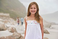 Girl 7_9 standing on beach portrait