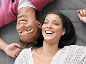 Cheerful Young Couple Lying Down