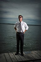 Businessman standing on dock