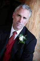 Man in a suit with flower on his lapel