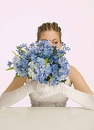 Bride holding blue flowers