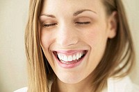Close_up of a young woman smiling