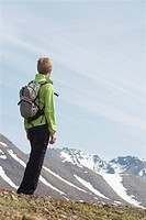 Hiker standing at a scenic lookout in the mountains