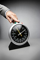 Businessman punching clock
