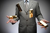 Businessman juggling gold bars
