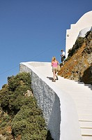 Climbing to Agios Constantinos chapel at the highest point of Chora main town, Serifos island, Greece