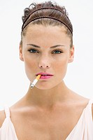 Portrait of a woman smoking a cigarette