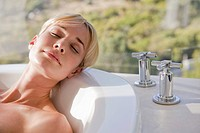 Close_up of a woman in a bathtub