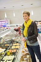 Woman choosing food in a supermarket