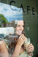 Woman drinking chocolate milkshake in a cafe (thumbnail)