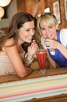 Women drinking bloody mary in a cafe