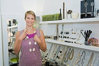 Woman wearing a necklace in a jewelry store