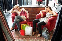 Two women napping in a boutique