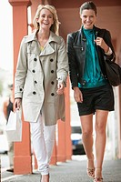 Two women walking in a corridor