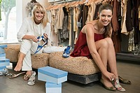 Two women trying on sandals in a boutique