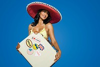 Woman in sombrero with suitcase