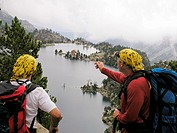 Mountaineers seeing Aiguestortes national park refuge  Pyrenees  Lerida  Catalonia  Spain