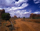 Dirt track leading through the dramatic rock formations of Monument Valley