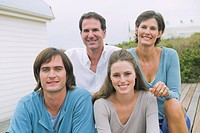 Portrait of a family smiling together
