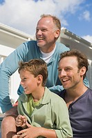 Two men smiling with a boy (thumbnail)