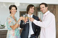 Man and his parents toasting with champagne