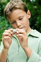 Boy holding a seashell