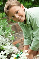Portrait of a boy gardening
