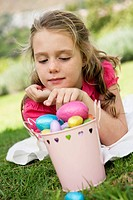 Girl looking at Easter eggs