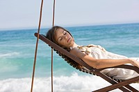 Woman resting in a deck chair (thumbnail)