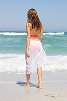 Woman standing on the beach (thumbnail)