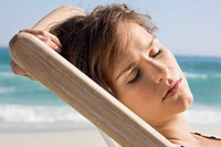 Close_up of a woman resting in a deck chair