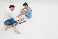 Couple playing with a sandbox
