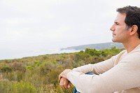 Man looking at sea view and thinking