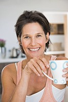 Portrait of a woman holding a cup of coffee