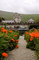 Glenveagh National Park, County Donegal, Ireland, Flowering Irish garden with castle in background