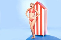 Woman in bikini by beach hut