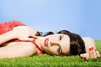 Young woman lying on artificial grass