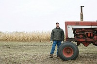 Farmer by tractor (thumbnail)