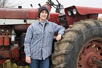 Female farmer by tractor