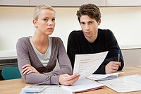 Young couple doing home finances