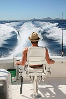 Man relaxing on boat, Cabo San Lucas, Mexico