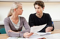 Serious young couple doing home finances